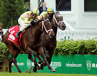LOUISVILLE, KY - MAY 05: La Coronel #1A, ridden by Florent Geroux, wins the Edgewood Stakes ahead of Dream Dancing #1, ridden by Julien Leparoux, on Kentucky Oaks Day at Churchill Downs on May 5, 2017 in Louisville, Kentucky. (Photo by Candice ChavezEclipse Sportswire/Getty Images)