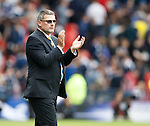 Craig Levein applauds the fans at full time
