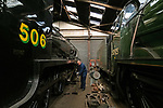 Pictured: Richard Bentley, Operations manager on the Midhants railway sweeps the floor as he is dwarfed by  a 1920 LSWR S15 class and a Cheltenham School Class 1935 steam train in the railyard in Ropley, Hants ahead of the proposed reopening of the Watercress Line in July. <br /> <br /> Due to the Coronavirus pandemic the railway is currently reliant on the cash reserves it had carefully built in order for future investment into the line.The Watercress Line requires over £800,000 of investment over the next couple of years and is using those savings at present to cover the overhead costs of the heritage line.<br /> <br /> The coronavirus pandemic forced the heritage railway line to close for only the second time in its history, and Midhants railway have set up a page accepting voluntary donations which will go directly towards future investment into the Watercress Line.<br /> <br /> © Jordan Pettitt/Solent News & Photo Agency<br /> UK +44 (0) 2380 458800
