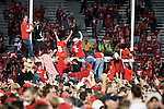Wisconsin Badger fans celebrate after upsetting number one ranked Ohio State Buckeyes after an NCAA college football game against the on October 16, 2010 at Camp Randall Stadium in Madison, Wisconsin. The Badgers beat the Buckeyes 31-18. (Photo by David Stluka)