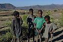 24/01/12. Lalibela, Ethiopia. Boys from the countryside around Lalibela, on the road to Yemrehane Christos. Photo credit: Jane Hobson.