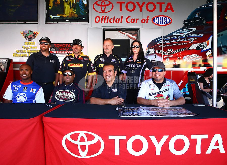 Jul. 26, 2014; Sonoma, CA, USA; NHRA Team Toyota (top L-R)  top fuel driver Shawn Langdon, Funny car driver Del Worsham, top fuel driver Richie Ceampton, funny car driver Alexis DeJoria, (bottom L-R) top fuel drivers Antron Brown, Khalid Albalooshi, funny car drivers Tony Pedregon and Cruz Pedregon during qualifying for the Sonoma Nationals at Sonoma Raceway. Mandatory Credit: Mark J. Rebilas-