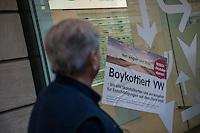 """Aktion der Kampagne """"VW Boykott"""" am Freitag den 6. Januar 2017 am Show Room der Volkswagen AG in Berlin.<br /> Aktivisten beklebten die Scheiben des VW-Volkswagen Group Forum in der Friedrichstrasse und Unter den Linden mit Aufklebern die zum Boykott von VW auf Grund des Abgasskandals aufrufen.<br /> Initiiert wurde die Kampagne vom Berliner Professor Peter Grottian (im Bild).<br /> 7.1.2017, Berlin<br /> Copyright: Christian-Ditsch.de<br /> [Inhaltsveraendernde Manipulation des Fotos nur nach ausdruecklicher Genehmigung des Fotografen. Vereinbarungen ueber Abtretung von Persoenlichkeitsrechten/Model Release der abgebildeten Person/Personen liegen nicht vor. NO MODEL RELEASE! Nur fuer Redaktionelle Zwecke. Don't publish without copyright Christian-Ditsch.de, Veroeffentlichung nur mit Fotografennennung, sowie gegen Honorar, MwSt. und Beleg. Konto: I N G - D i B a, IBAN DE58500105175400192269, BIC INGDDEFFXXX, Kontakt: post@christian-ditsch.de<br /> Bei der Bearbeitung der Dateiinformationen darf die Urheberkennzeichnung in den EXIF- und  IPTC-Daten nicht entfernt werden, diese sind in digitalen Medien nach §95c UrhG rechtlich geschuetzt. Der Urhebervermerk wird gemaess §13 UrhG verlangt.]"""
