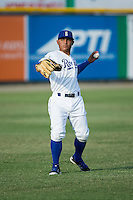Cristhian Vasquez (44) of the Burlington Royals warms up in the outfield prior to the game against the Princeton Rays at Burlington Athletic Stadium on June 24, 2016 in Burlington, North Carolina.  The Rays defeated the Royals 16-2.  (Brian Westerholt/Four Seam Images)