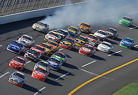 Apr 29, 2007; Talladega, AL, USA; Nascar Nextel Cup Series driver Jamie McMurray (26) leads the field as David Reutimann (00) blows his engine during the Aarons 499 at Talladega Superspeedway. Mandatory Credit: Mark J. Rebilas