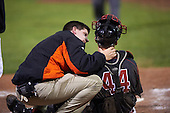 Batavia Muckdogs trainer Eric Reiglsberger talks with catcher Jarett Rindfleisch (44) after getting hit during a game against the Williamsport Crosscutters on September 3, 2016 at Dwyer Stadium in Batavia, New York.  Williamsport defeated Batavia 10-0. (Mike Janes/Four Seam Images)