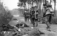 BNPS.co.uk (01202 558833)<br /> JonDiamond/BNPS<br /> <br /> A section of the 15th Scottish Division's 6th KOSB advance past dead Germans on the east side of the Rhine. <br /> <br /> Remarkable rarely seen photos of heroic Allied soldiers fighting their way across Europe before crossing the River Rhine 75 years ago feature in a new book.<br /> <br /> They are published in Images of War, Montgomery's Rhine Crossing, which tells the story of the legendary offensive, nicknamed Operation Plunder, in March 1945.<br /> <br /> On the night of March 23, Field Marshal Bernard Montgomery's 21st Army Group launched a massive artillery, amphibious and airborne assault to breach the historic defensive water barrier protecting northern Germany.<br /> <br /> At the same time, the Americans, with the support of the British 6th Airborne Division, set in motion Operation Varsity - involving 16,000 paratroopers - on the east bank of the Rhine. They were dropped here to seize bridges to prevent German reinforcements from contesting the bridgeheads.<br /> <br /> Fierce fighting ensued, with much bloodshed on both sides as the Allies met determined resistance from machine gun nests. But the daring operation proved successful, helping to considerably shorten the war - the Nazis surrendered just six weeks later.