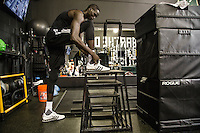 Milwaukee Bucks player Thon Maker, 19, works out before practice with strength and conditioning coach Michael Davie, at the Milwaukee Bucks practice facility.