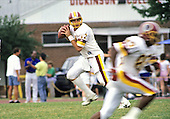 Washington Redskins quarterback Mark Rypien (11) looks for a receiver during drills at the Washington Redskins training camp at Dickinson College in Carlisle, Pennsylvania on July 26, 1993.<br /> Credit: Ron Sachs / CNP