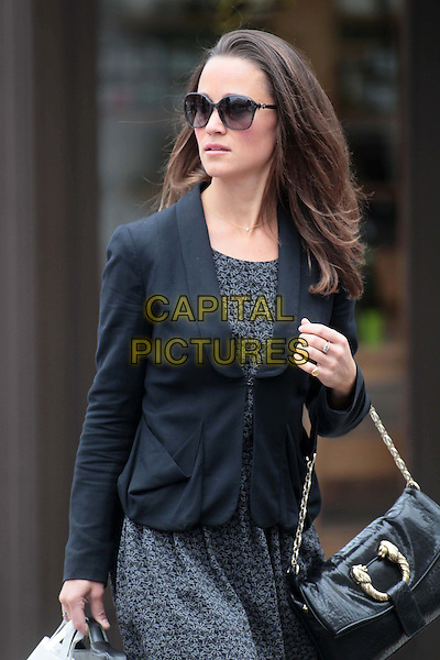 Pippa Middleton spotted in London, England..July 20th, 2011.half length black jacket blazer grey gray print dress sunglasses shades bag purse.CAP/HIL.©John Hillcoat/Capital Pictures.