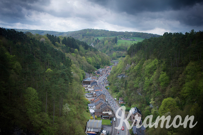 birds view of the peloton going through a village early in the race with dark skies overhead<br /> <br /> 101th Liège-Bastogne-Liège 2015