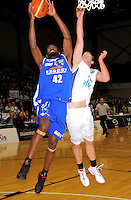 Saints import Kareem Johnson lays a shot up under pressure from Sam Dempster. NBL - Wellington Saints v Nelson Giants at TSB Bank Arena, Wellington, New Zealand on Thursday, 19 May 2011. Photo: Dave Lintott / lintottphoto.co.nz