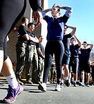 WATERBURY CT. 16 March 2018-031619SV03-Staff Sgt. Jesus Torres of the United States Marines, not in photo, runs 50 recruits threw a workout session outside Universal Fitness on Watertown Avenue in Waterbury Saturday. Most of the area recruits were getting ready to head off to boot camp or were thinking of signing up for service.<br /> Steven Valenti Republican-American