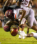 Virginia Tech Virginia Tech linebacker Rayshard Ashby (23) upends Florida State running back Jacques Patrick (9) an NCAA college football game between Florida State and Virginia Tech in Tallahassee, Fla., Monday, Sept. 3, 2018. (AP Photo/Mark Wallheiser)