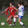Lauryn Shin #13 of Syosset, left, and Nicole Leary #28 of East Meadow battle for possession during a Nassau County Class AA varsity girls soccer quarterfinal at East Meadow High School on Tuesday, Oct. 25, 2016. Shin scored Syosset's second of two goals in the Lady Braves' 2-1 win.