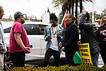 SACRAMENTO, CALIFORNIA - MARCH 3, 2019: Outside the Arden Fair Mall, angry shoppers, left, confront activists protesting the Sacramento County District Attorney's decision to not charge the Sacramento Police Department officers who shot an unarmed Stephon Clark in 2018. Mall management closed the mall Sunday after an overnight sit-in by protestors. CREDIT: Max Whittaker for The New York Times