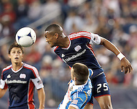 New England Revolution defender Darrius Barnes (25) strong header. In a Major League Soccer (MLS) match, the New England Revolution tied Philadelphia Union, 0-0, at Gillette Stadium on September 1, 2012.