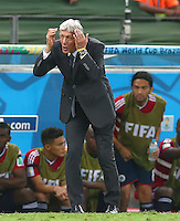 Colombia coach Jose Pekerman shows a look of dejection on the touchline