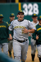 Jordan Spencer #23 of the Oregon Ducks runs between innings during a baseball game against the USC Trojans at Dedeaux Field on March 15, 2013 in Los Angeles, California. (Larry Goren/Four Seam Images)