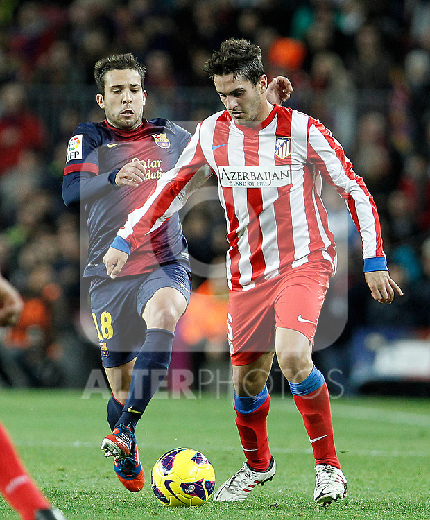 FC Barcelona's Jordi Alba (l) and Atletico de Madrid's Koke during La Liga match.December 16,2012. (ALTERPHOTOS/Acero)