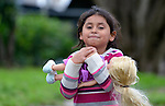 A five-year old refugee child holds a doll in San Antonio, Texas. The girl and her mother and two siblings fled Guatemala in 2015 because of violence caused by narcotraffickers. After requesting political asylum in the United States, they were held for several days by immigration officials and then released, after which they stayed in a shelter now run by the Refugee and Immigrant Center for Education and Legal Services (RAICES), and supported by a coalition of San Antonio churches.  They have since settled in San Antonio awaiting a final decision on their asylum request.