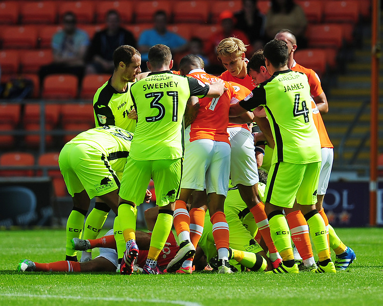 Players from both sides rush in after Exeter City's Craig Woodman is fouled by Blackpool's Danny Pugh<br /> <br /> Photographer Kevin Barnes/CameraSport<br /> <br /> Football - The EFL Sky Bet League Two - Blackpool v Exeter City - Saturday 6th August 2016 - Bloomfield Road - Blackpool<br /> <br /> World Copyright © 2016 CameraSport. All rights reserved. 43 Linden Ave. Countesthorpe. Leicester. England. LE8 5PG - Tel: +44 (0) 116 277 4147 - admin@camerasport.com - www.camerasport.com