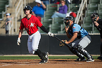 Zach Fish (24) of the Kannapolis Intimidators follows through on his swing against the Hickory Crawdads at Kannapolis Intimidators Stadium on April 10, 2016 in Kannapolis, North Carolina.  The Intimidators defeated the Crawdads 10-3.  (Brian Westerholt/Four Seam Images)