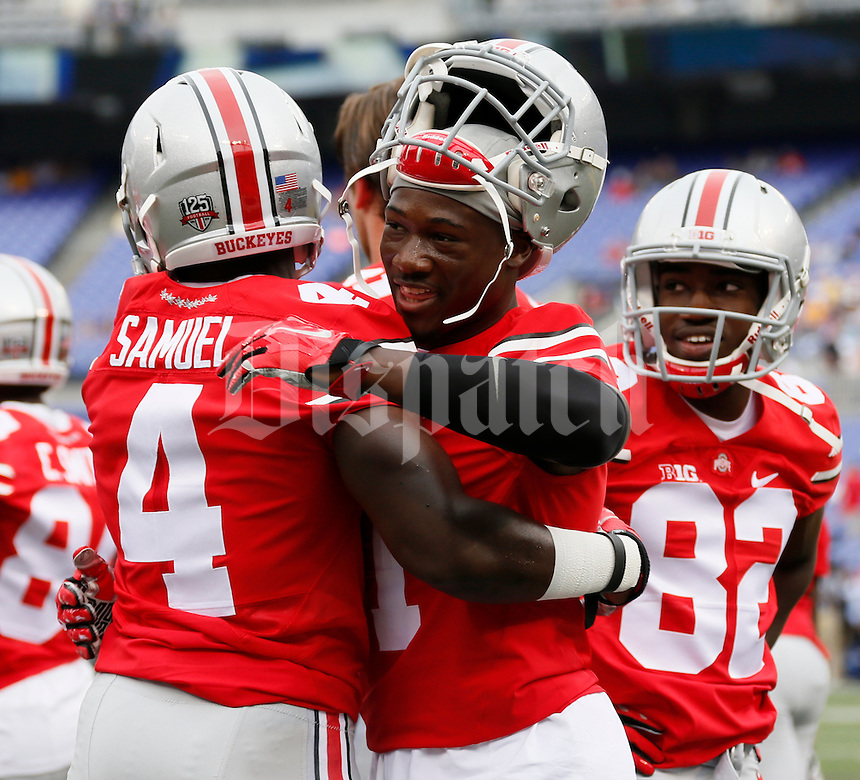 Ohio State Buckeyes running back Curtis Samuel (4) and Ohio State Buckeyes wide receiver Johnnie Dixon (1) embrace before during Saturday's NCAA Division I football game against the Navy Midshipmen at M&T Bank Stadium in Baltimore on August 30, 2014. (Dispatch Photo by Barbara J. Perenic)