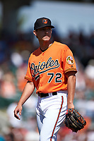 Baltimore Orioles relief pitcher Hunter Harvey (72) walks to the dugout during a Spring Training game against the Minnesota Twins on March 7, 2016 at Ed Smith Stadium in Sarasota, Florida.  Minnesota defeated Baltimore 3-0.  (Mike Janes/Four Seam Images)
