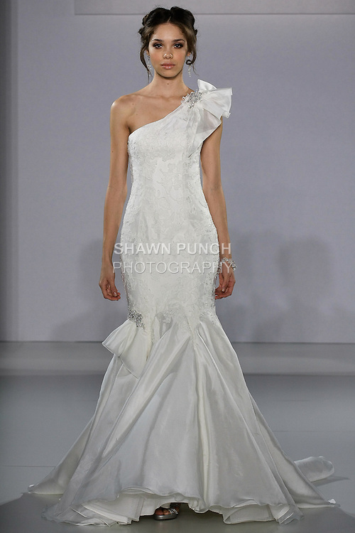 Model walks runway in an Evita wedding gown from the Maggie Sottero Spring 2013 collection, at The Couture Show, during New York Bridal Fashion Week, on October 14, 2012.