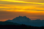 Red skies cause a beautiful sunset over the Olympic mountains as seen from Port Orchard, Washington. The Olympic Mountains is a year-round destination. In summer, visitors come for views of the Olympic Mountains, as well as for superb hiking. Jim Bryant Photo. ©2016. All Rights Reserved.
