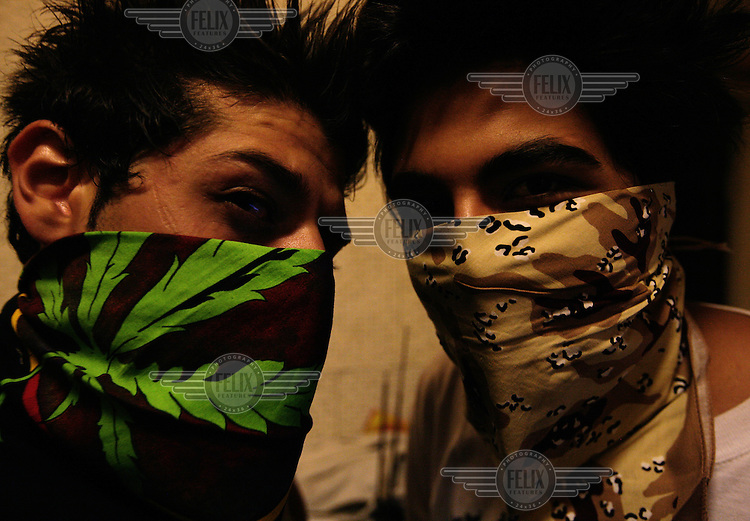 Members of the Hidden Mafia can not walk around the streets of Tehrna dressed as they like they do behind the lcosed doors of the studio. Since the revolution of 1978, Iran has been living under strict Islamic rule. One law that has been enforced on iranian is banning the preformance of western music in public. Jazz, rock, hip hop, heavy metal and more have been deemed forbidden by the government. Despite threats od imprisonment, whipping and other punisments, Tehran youth defy the ban and continue to create music in underground studios. Some who are good enough are signed up by record companies overseas and eventually leave Iran for more prosperous oppportunities in the West. But some are ademant about staying in Iran and trying to build a music scene under the increasingly difficult condtions.