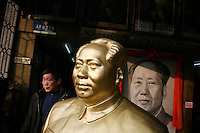 CHINA. Hubei Province. Wuhan. A man walks past a statue of the former Chinese leader Mao Zedong in the gardens of The Yellow Crane Tower which looks over the Yangtze and the city of Wuhan.  2008.