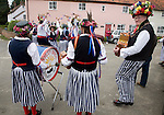 Traditional Morris Men doing country dancing in the village of Shottisham, Suffolk, England