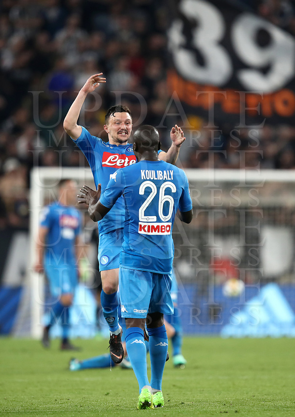 Calcio, Serie A: Juventus - Napoli, Torino, Allianz Stadium, 22 aprile, 2018.<br /> Napoli's Kalidou Koulibaly and Mario Rui celebrate after winning 1-0  the Italian Serie A football match between Juventus and Napoli at Torino's Allianz stadium, April 22, 2018.<br /> UPDATE IMAGES PRESS/Isabella Bonotto
