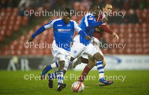 Aberdeen v St Johnstone..22.12.12      SPL.Nigel Hasselbaink's late shot is saved by Jason Brown.Picture by Graeme Hart..Copyright Perthshire Picture Agency.Tel: 01738 623350  Mobile: 07990 594431