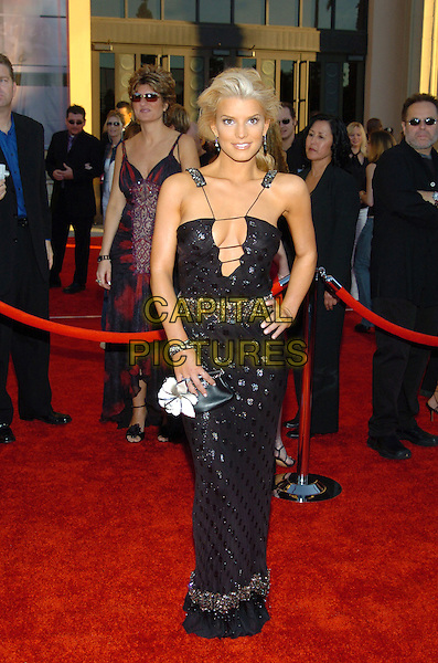 JESSICA SIMPSON.32nd Annual American Music Awards held at the Shrine Auditorium. .14 November 2004.full length, hand on hip, black dress, plunging neckline, claevage, straps.www.capitalpictures.com.sales@capitalpictures.com.© Capital Pictures.