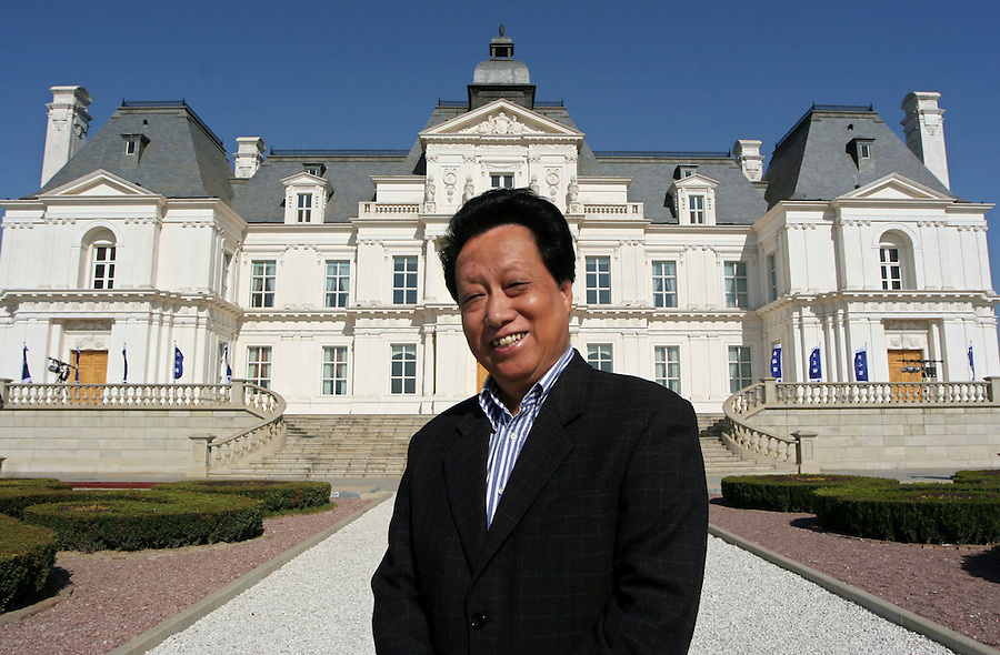 Beijing, China - October 21, 2005 -  Jiang You Chen poses in front of his Lafitte Chateau Hotel a replica of a 17th-century French castle on the outskirts of Beijing. Economic reform has made him part of a group of 10,000 Chinese worth more than $10 million. The chateau cost $50 million to build. Jiang was a senior official in the Beijing Construction Bureau before making his fortune as a property developer.  To match feature by Richard Spencer Photo by Natalie Behring