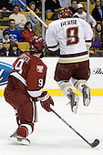 Nathan Gerbe (Boston College - Oxford, MI) leaps out of the way of a BC shot while being defended by Jimmy Fraser (Harvard University - Port Huron, MI). The Boston College Eagles defeated the Harvard University Crimson 3-1 in the first round of the 2007 Beanpot Tournament on Monday, February 5, 2007, at the TD Banknorth Garden in Boston, Massachusetts.  The first Beanpot Tournament was played in December 1952 with the scheduling moved to the first two Mondays of February in its sixth year.  The tournament is played between Boston College, Boston University, Harvard University and Northeastern University with the first round matchups alternating each year.