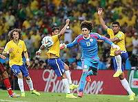 Man of The Match Mexican Goalkeeper Guillermo Ochoa clears the ball