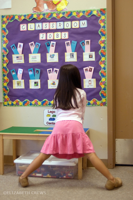 Alameda CA Kindergarten student looking over job allocations for students' assignments