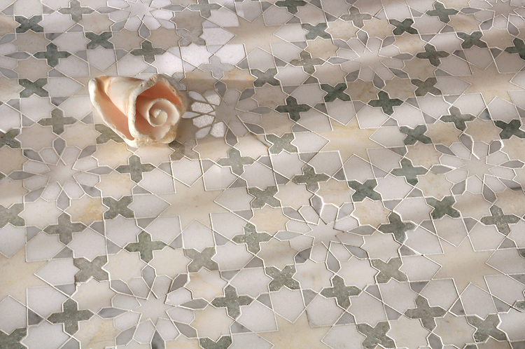 Granada, a handmade mosaic shown in Heavenly Cream, Cloud Nine, Ming Green, Carrara, and Thassos, is part of the Miraflores collection by Paul Schatz for New Ravenna.