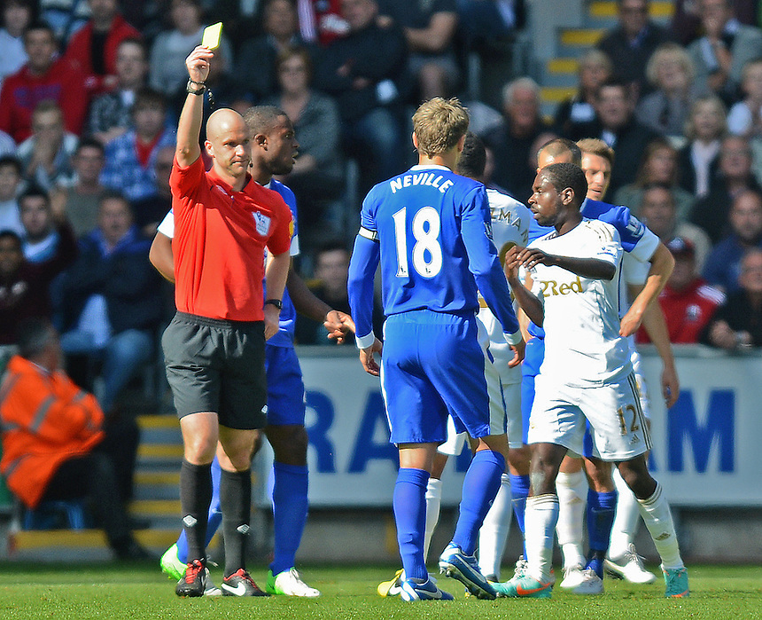 Referee Anthony Taylor shows Swansea City's Nathan Dyer second yellow card of the game..Football - Barclays Premiership - Swansea City v Everton - Saturday 22nd September 2012 - Liberty Stadium - Swansea..