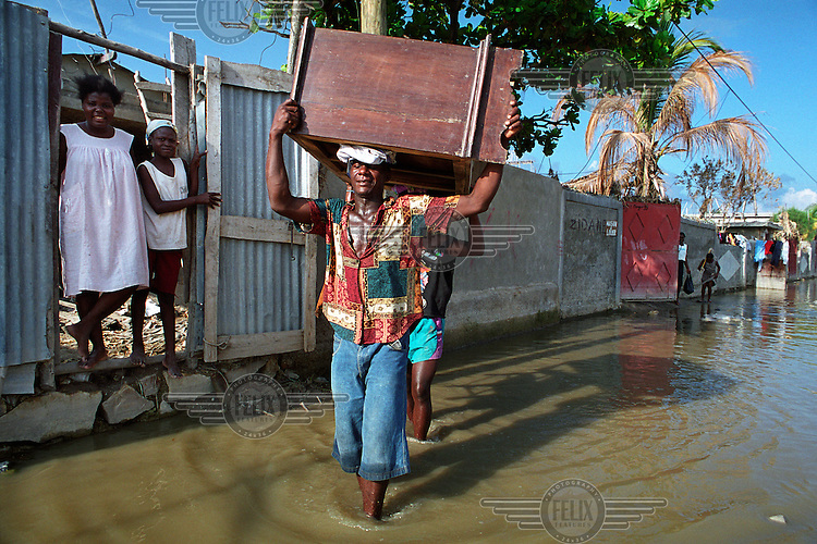 Three weeks after tropical storm Jeanne hit the city of Gonaives parts of the Asifa neighbourhood are still flooded. Over 2700 people were reported dead or missing. Haiti is particularly vulnerable to flooding after heavy rainfall due to intense deforestation.