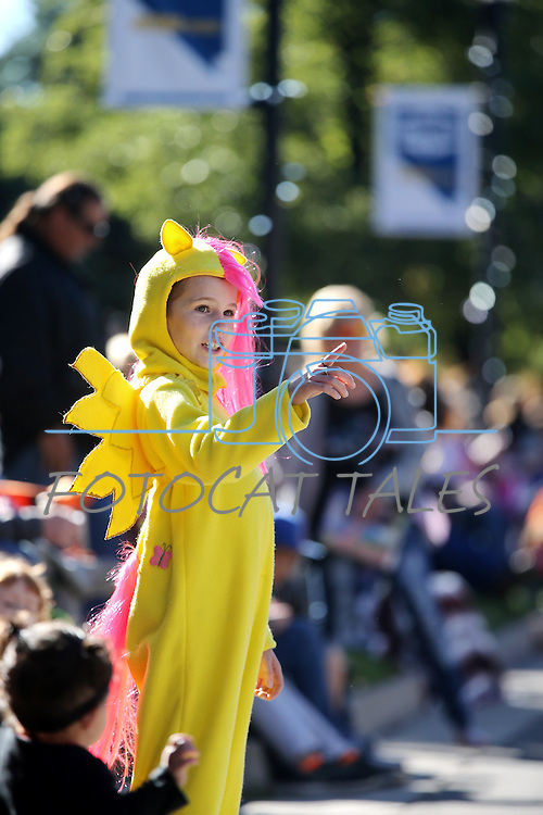 Sophia Gangestad, 8, of Dayton, watches the Nevada Day parade in Carson City, Nev., on Saturday, Oct. 31, 2015. <br /> Photo by Cathleen Allison