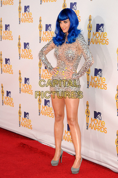 KATY PERRY .MTV Movie Awards 2010 - Arrivals held at the Gibson Amphitheatre, Universal City, California, USA, 6th June 2010..full length blue hair dyed wig silver sparkly jewel gem encrusted embellished flesh tone mesh mini body con dress long sleeved sleeves platform grey gray shoes heels bright neon yellow nails nail varnish polish manicure fluorescent hands on hips .CAP/ADM/BP.©Byron Purvis/AdMedia/Capital Pictures.