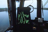 """- pusher of """"Fluviopadana"""" company with barges in navigation on the Po river, the bridge and radar....- spintore della compagnia """"Fluviopadana"""" e chiatte in navigazione sul fiume Po, plancia di comando e radar"""