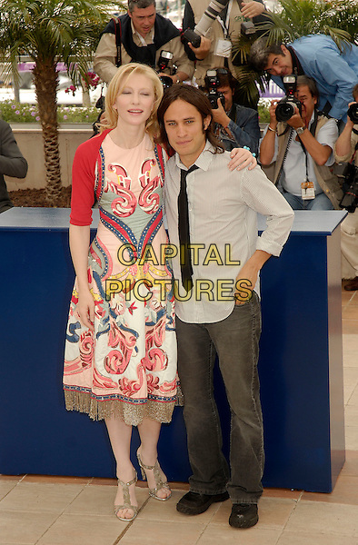 "CATE BLANCHETT & GAEL GARCIA BERNAL.""Babel""  photocall at the 59th International Cannes Film Festival, Cannes, France..May 23rd, 2006.Ref: KRA.full length pink pattern print dress jeans denim.www.capitalpictures.com.sales@capitalpictures.com.©Persun/Capital Pictures"