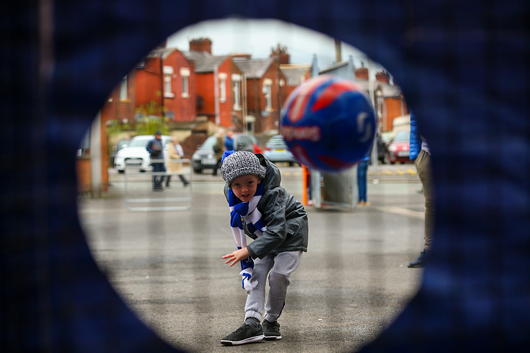 A young Blackburn Rovers fan tries his luck at a shootout game, outside Ewood Park<br /> <br /> Photographer Alex Dodd/CameraSport<br /> <br /> The EFL Sky Bet Championship - Blackburn Rovers v Queens Park Rangers - Saturday 3rd November 2018 - Ewood Park - Blackburn<br /> <br /> World Copyright © 2018 CameraSport. All rights reserved. 43 Linden Ave. Countesthorpe. Leicester. England. LE8 5PG - Tel: +44 (0) 116 277 4147 - admin@camerasport.com - www.camerasport.com