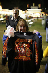 A woman shows her new shirt at the greater Baton Rouge State Fair Louisiana Thursday Oct 23 2008. Americans will go to the polls on Nov 4, at a time of great Financial crisis, war in Iraq and Afghanistan, to elect a  new President. A vote, that will affect not only America, but the whole world. Photo by Eyal Warshavsky .